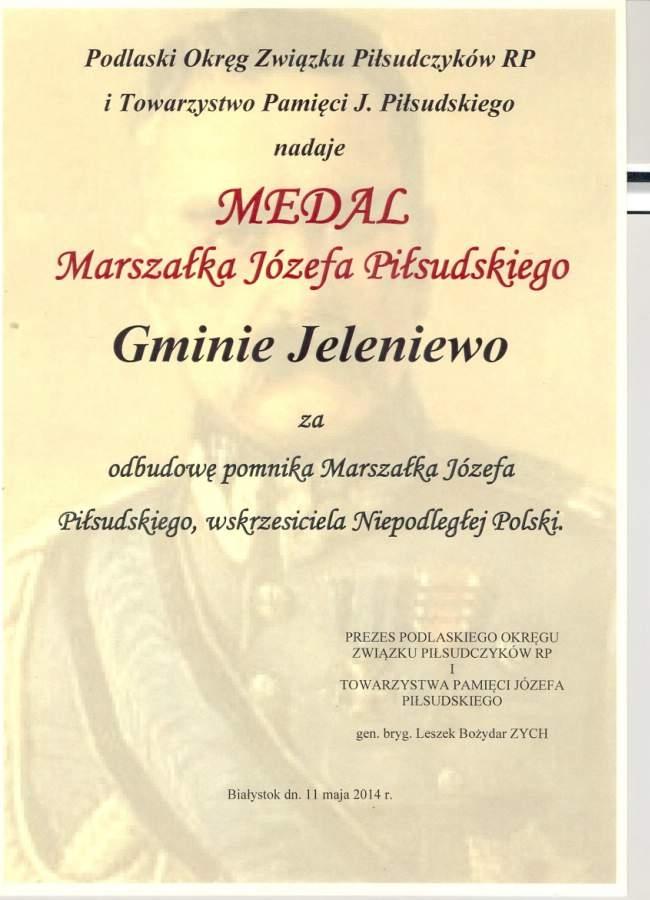 Medal Marszałka Józefa Piłsudskiego nadany Gminie Jeleniewo              <br>11 maja 2014 r. przez Podlaski Okręg Związku Piłsudczyków RP i Towarzystwo Pamięci J.Piłsudskiego